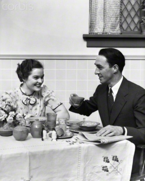 "Couple circa 1930 are seen enjoying a bowl of the  ""new"" breakfast food: Cereal."