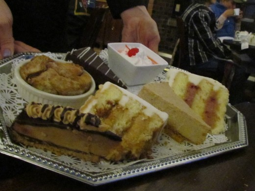 The dessert tray at the Red Coach Inn, was filled with a variety of tantalizing sweets such as Lemon Raspberry Cake, Carmel Swirl Cake, Chocolate and Peanut Butter Cheesecake.