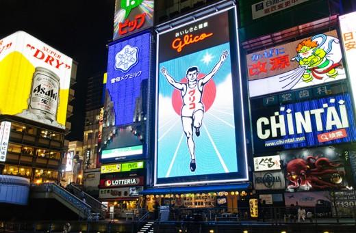 "The large neon signs of Osaka's Dotonbori area, and its signature ""Glico Man."""