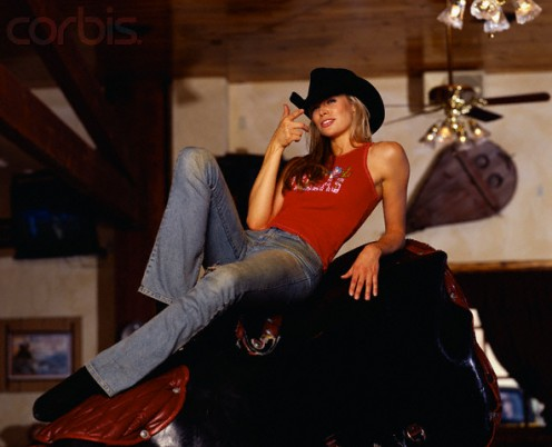 Actress Brooke Burns  on mechanical bull,  the main reason that the  Cowboy Fad died in USA.