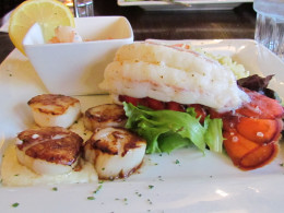 Pan Seared scallops, lobster tail, tiger shrimp and a medley of vegetables were served at the Red Coach Inn