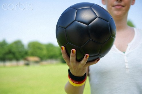 Red nails can be worn even in fast, competitive games such as soccer.