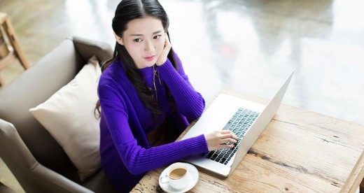young-woman-purple-sweater-laptop-mst