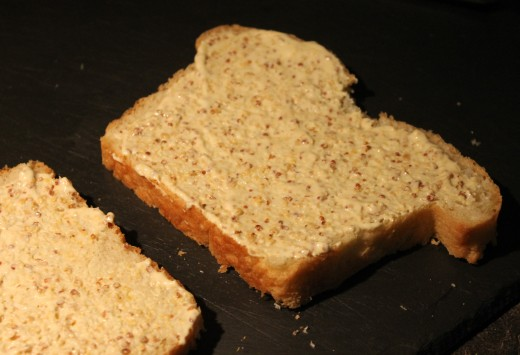 Homemade white bread schmeared with grainy mustard 'aioli'