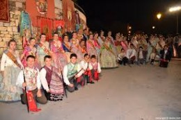 Thousands of locals parade in traditional dresses accompanied by regional music