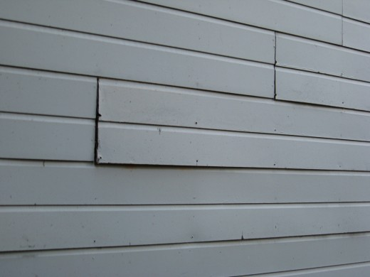 Warped, bowed out siding.