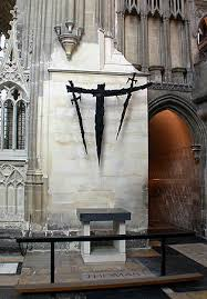 Showing recent (1986) sculpture of four swords (two and two shadows) to remind of the weapons wielded by the Knights who killed Thomas a Beckett, Canterbury Cathedral