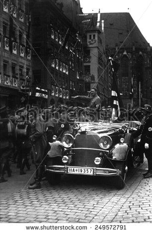 Hitler salutes the SS Storm Troopers during a Nazi parade.