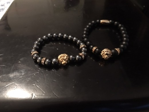 Custom beaded  Zenger lions head 14k gold bracelet from eBay seller Kenjohnn (left)34$ . Zorrata 14k lions head bracelet (right) 60$.