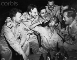 American GI's enjoying a beer. Photo taken, May 30, 1943.