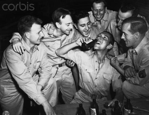 American GI's enjoying a beer. Photo taken, May 30, 1943.