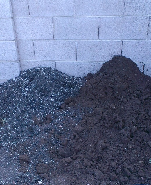 Soil mixes are easily identified by the supplements within them. The left pile contains pearlite which helps maintain moisture and is commonly seen in container potting soil. The dark pile on the right is organic gardening soil.
