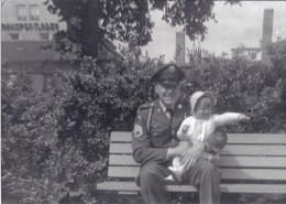 Me and my Dad sitting on a bench in Germany.