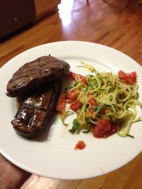 Steak and zucchini with tomatoes for dinner.
