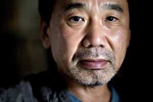 In this photo, Haruki Murakami looks as if he has spent too many hours contemplating reality from the bottom of a well.