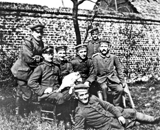 Hitler(on the far-right, sitting) was a devoted and fanatical soldier. He had good relationships with many of his fellow soldiers.