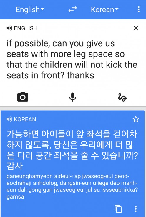 We asked for seats on the airplane with more leg space using Google Translate.