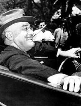 President Franklin Roosevelt smoking a cigarette in his trademark cigarette holder.