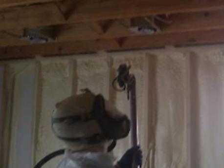 Spray foam contractor installs closed cell foam.