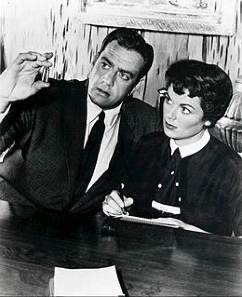 Perry Mason, (Raymond Burr), Barbara Hale, (Della Street) talk about a case Mason is working on.