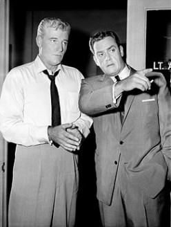 William Hopper, (Paul Drake) and Perry Mason, (Raymond Burr), inspect a crime scene where Mason's client was allegedly seen only moments before a tragic crime was committed.