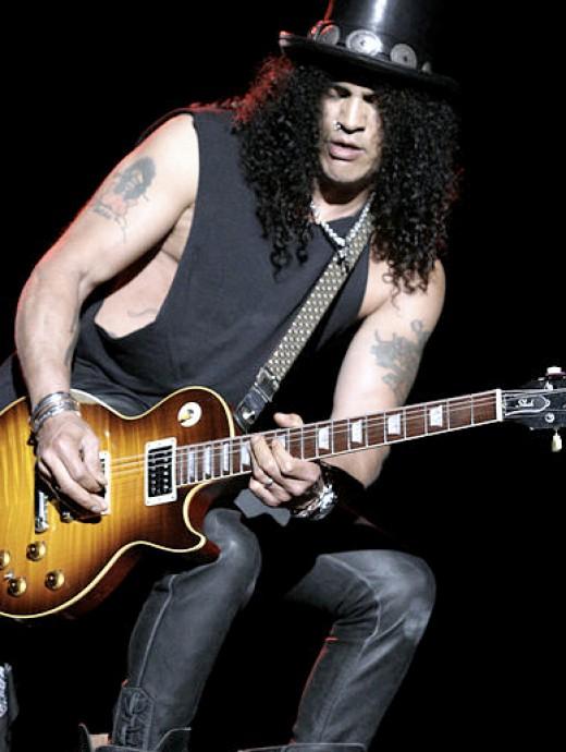 Slash playing a Les Paul