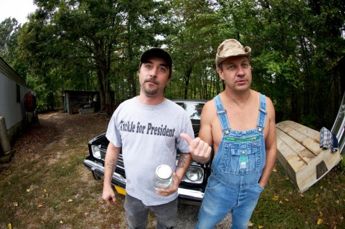 Two real moonshiners pose for the camera