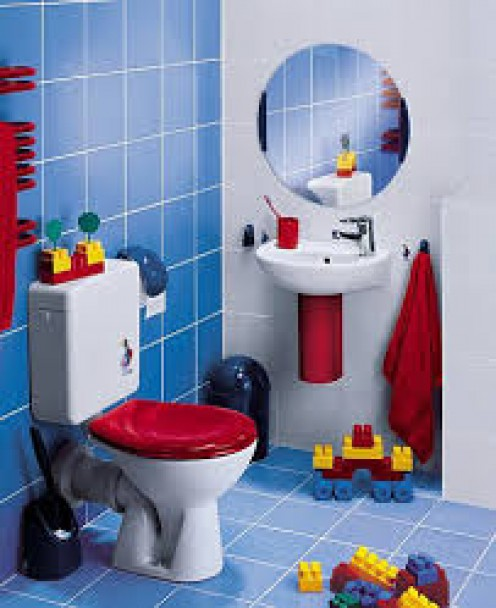 What a difference simply adding a red toilet seat and little dash of red here and there have made in this setting.