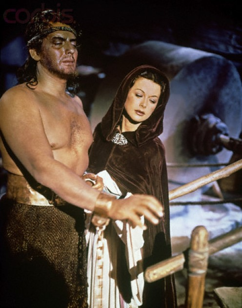 "Victor Mature, ""Samson,"" now blinded by the Philistines, is comforted by Hedy Lamaar, ""Delilah,"" who did have love for him"
