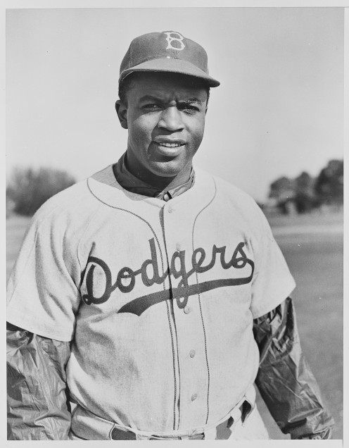 A photo of the baseball player Jackie Robinson wearing the Dodgers uniform back in 1950.