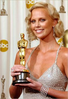 Just as well, Theron was wearing a Gucci gown during 2004's Oscar night.