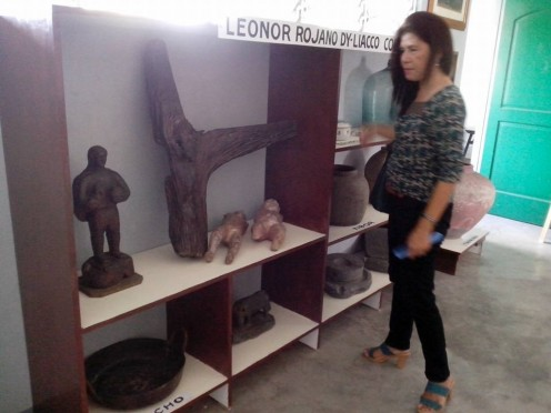 One of the guest-teacher of Minalabac viewing the Leonor Rojano-Dy Liacco Collection inside the Tumatarok Museum (Photo Source: Ireno Alcala, Apr24,2016)