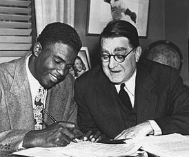 Dodger GM Branch Rickey signing Jackie Robinson