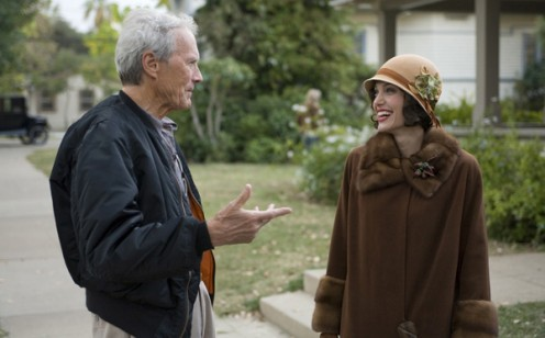 Angelina Jolie and director Clint Eastwood on the set of Changeling (2008)