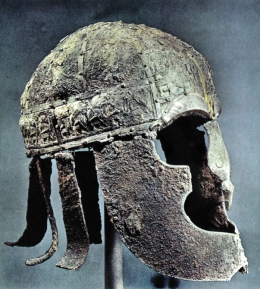 The Vendel helm found nearby resembled a Greco-Roman style with broad cheek guards. Common to both are the neck guards, strips of metal that were forerunners of the mail neckguards. They might  deflect a glancing blow, but not one aimed at the neck