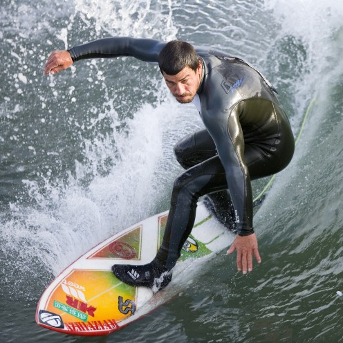 """""""Man, I am such a fine surfer that  those girls on the beach are talking about me."""""""