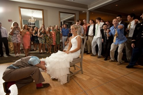 The groom finds the bride's garter