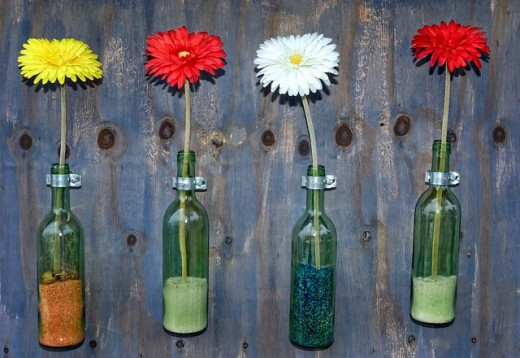 Use individual containers of color for dying each flower stem.