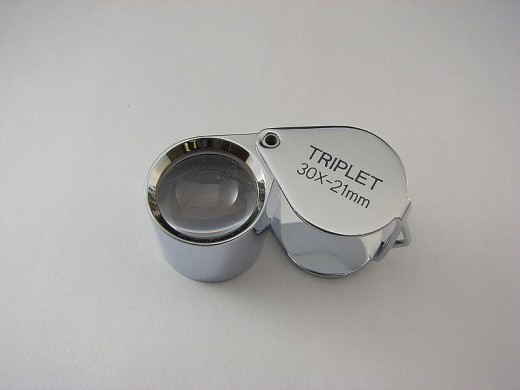 A type of magnifying glass known as a loupe enables the fine detail of hallmarks to be read.