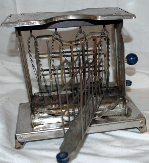 An antique toaster from the 1920s.  Whatever you do, don't get your hand caught in here!