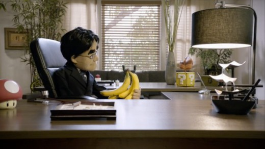 The Late Satoru Iwata contemplates a bunch of bananas during his last E3 appearance, in puppet form.