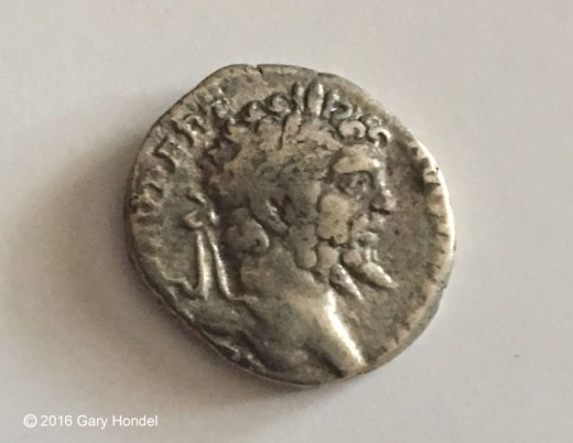 Detail of Silver Denarius Coin with Image of Caesar Augustus