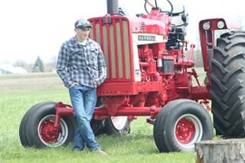 A perfect combination: A farm boy and his tractor