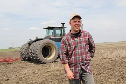 This farmer's pride is evident for how easily he plowed this field