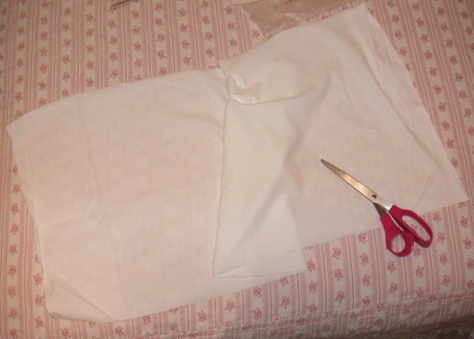 Create a long strip of t-shirt fabric by cutting open the side fold.
