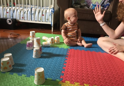 Baby just knocked over the stack of five cups!