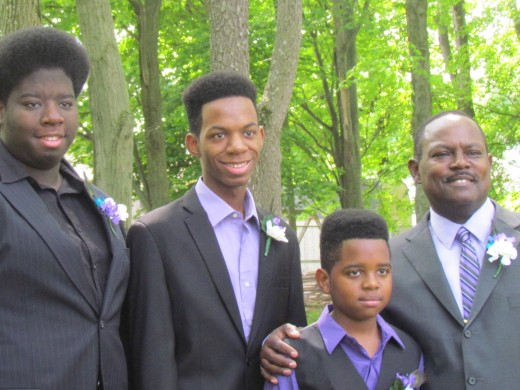 Stephen, poses with his son Michael and  stepsons Jahshua and Elijah.