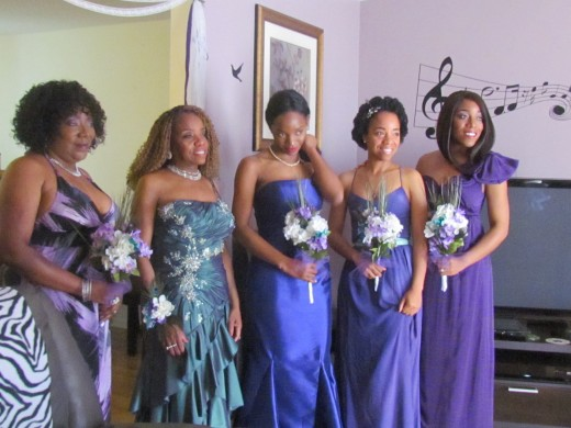 The bridesmaids Kasia, mother of the bride Paulette, daughter LaShae, Jaleesa and Wanisha.