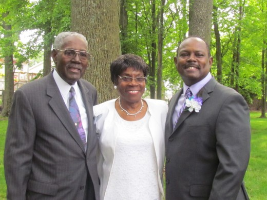 Stephen, the groom poses with his dad Israel Williams who performed the ceremony, along with his Stepmom, Ann Williams.
