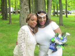 Auntie Claudette, takes a photo with the beautiful bride.